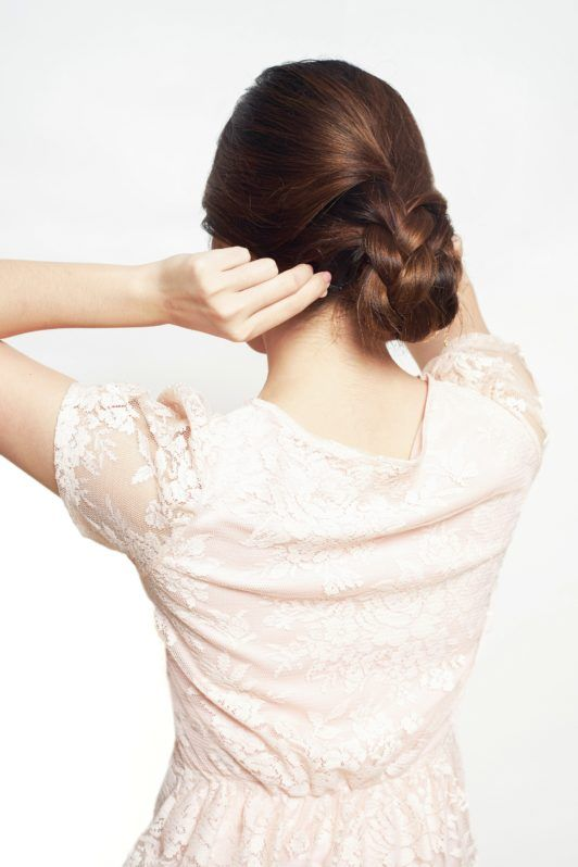 How to make a braided updo step 6: Wrap the second braid around the bun