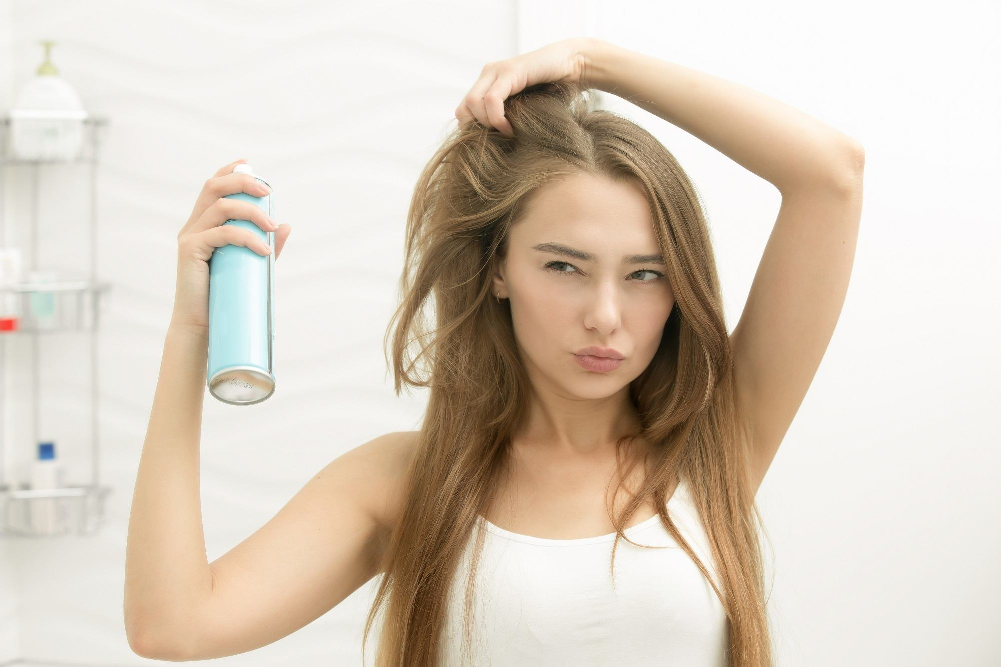 Night time hair care routine: Spray dry shampoo on your hair.