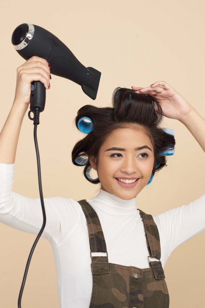 How to use hair rollers step 5: Blow dry hair with the hair rollers still on