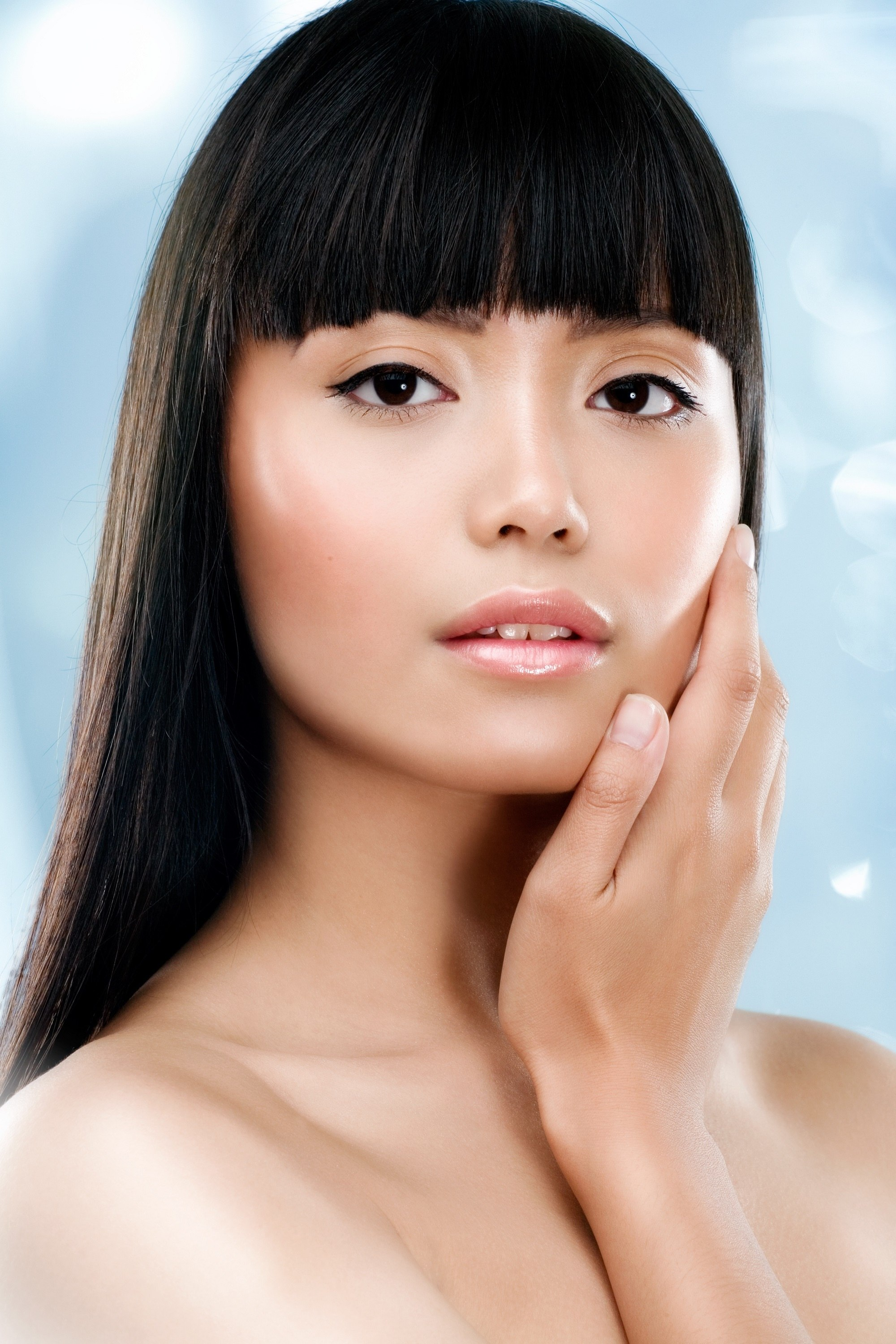 Asian woman with straight bangs and long straight hair