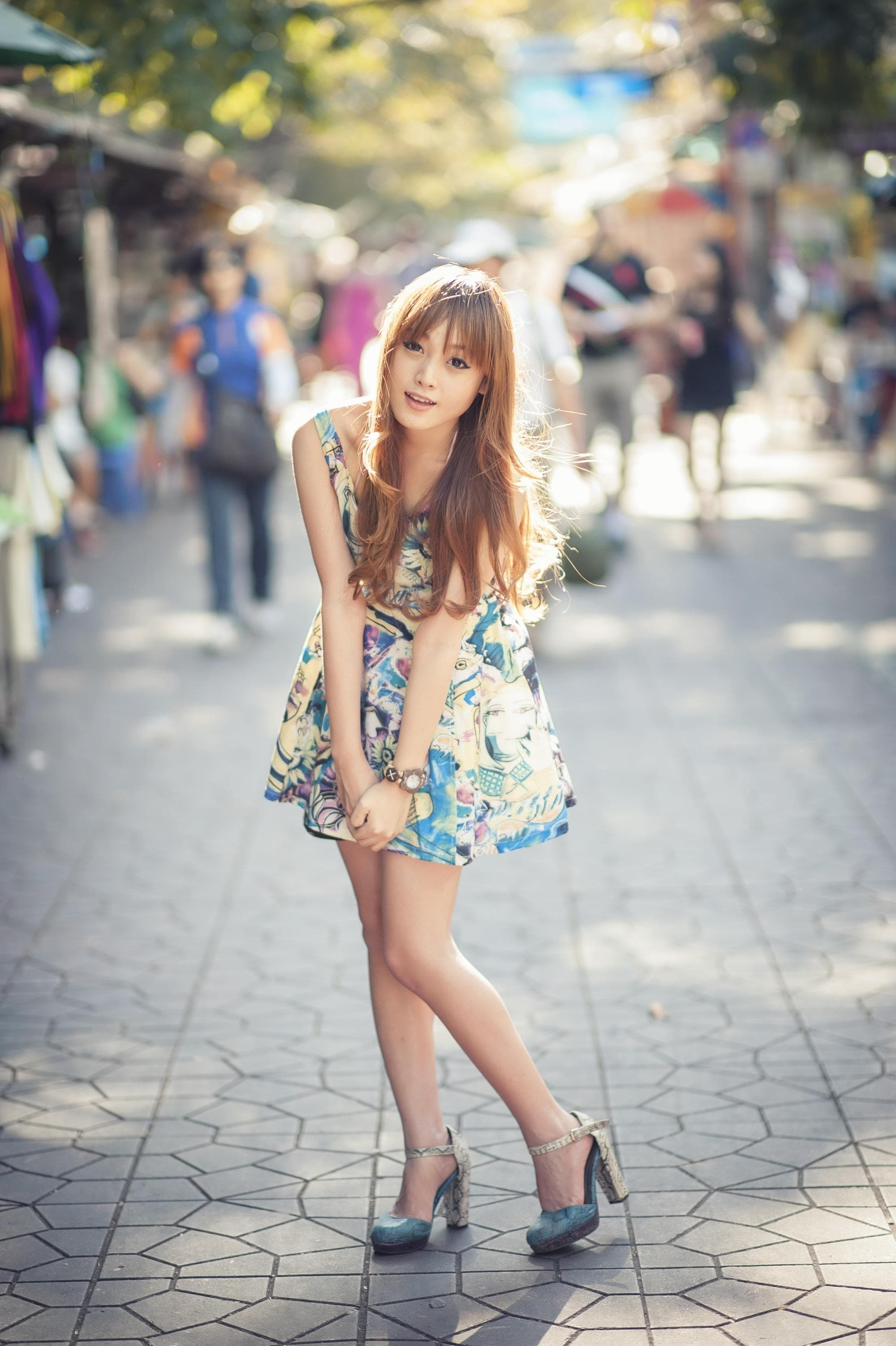 Asian woman with straight bangs and long hair