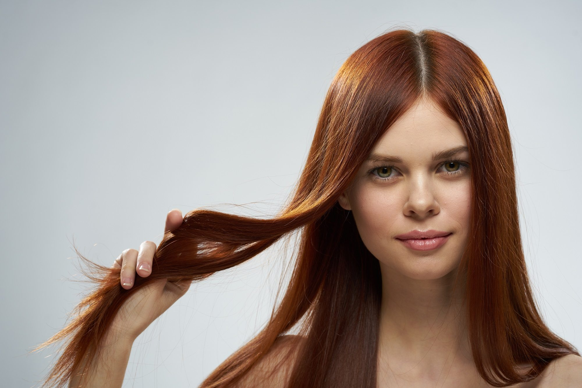 Woman with long straight cinnamon hair