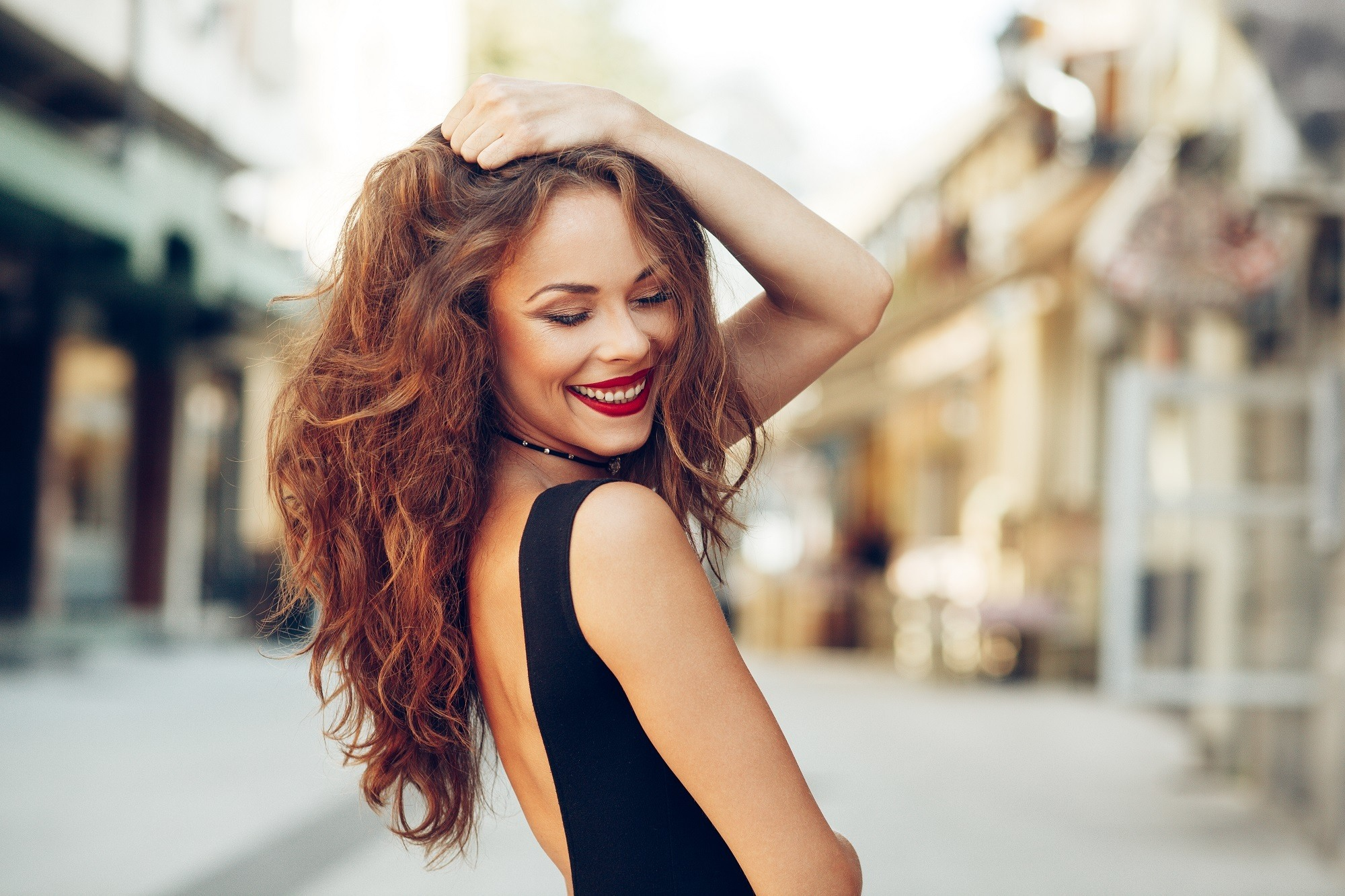 Curls for long hair: Woman with long brown curly hair