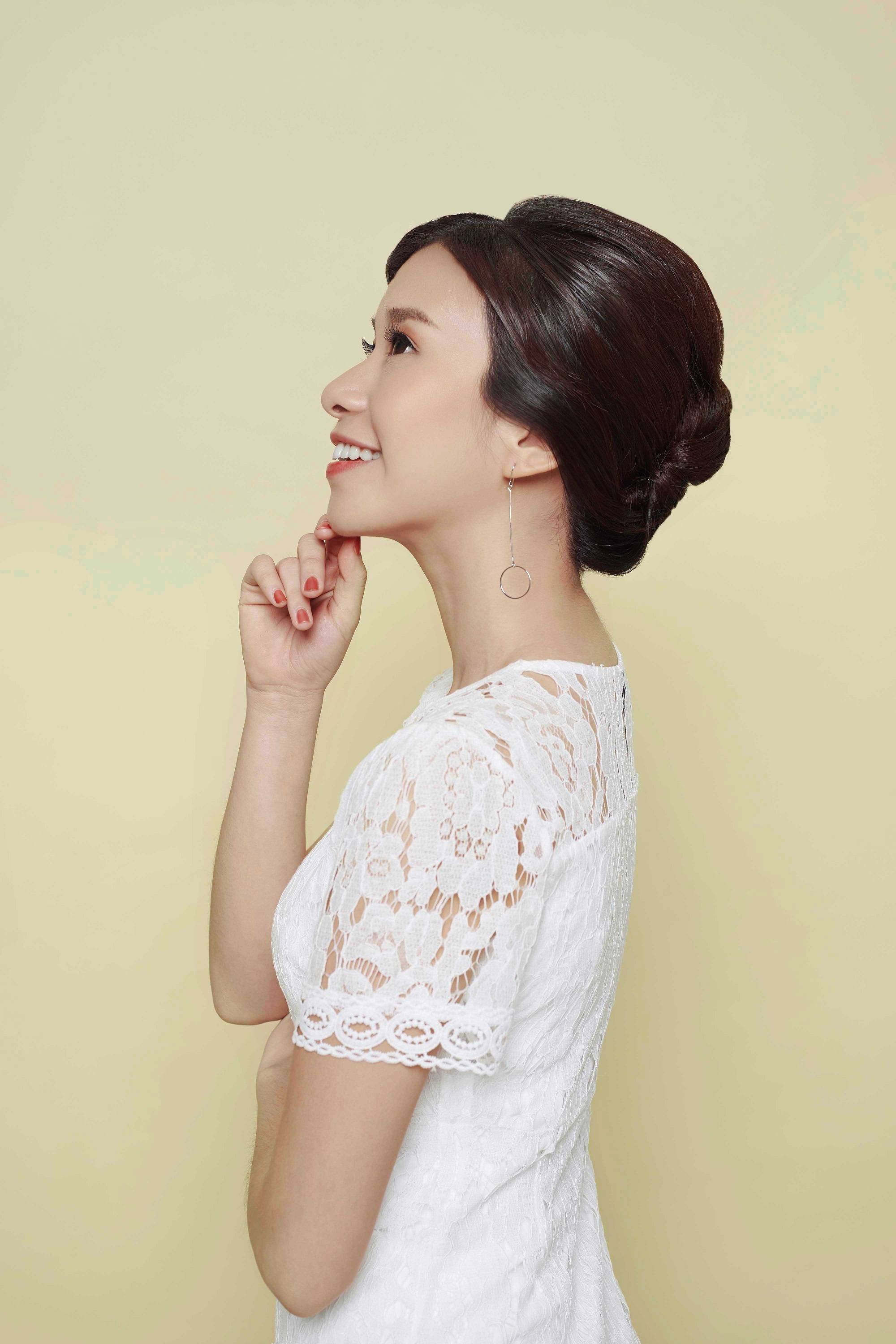 Elegant updos: Asian woman with French twist hair