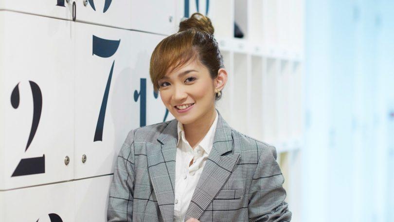 Asian woman with ballerina bun and faux bangs
