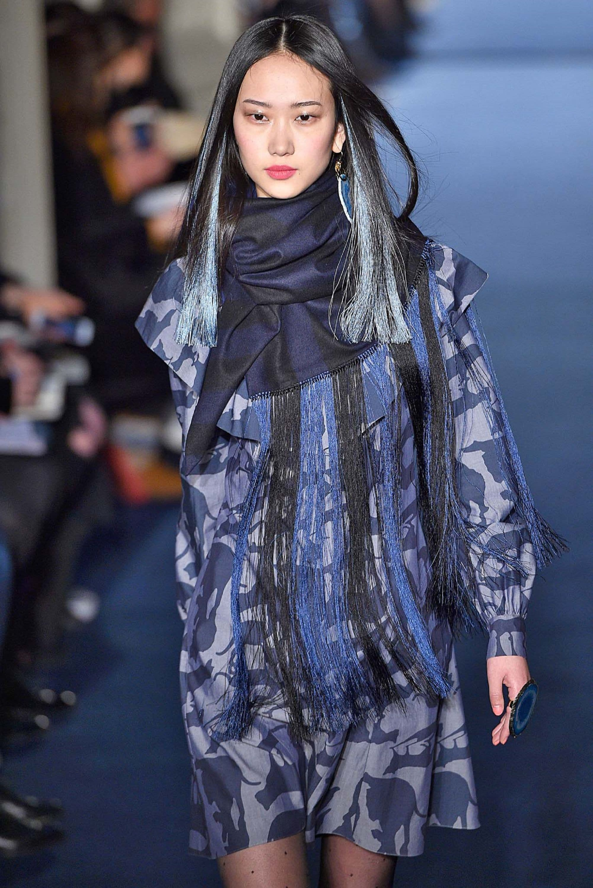 Hair colors for long hair: Asian woman with long black hair and ice blue highlights