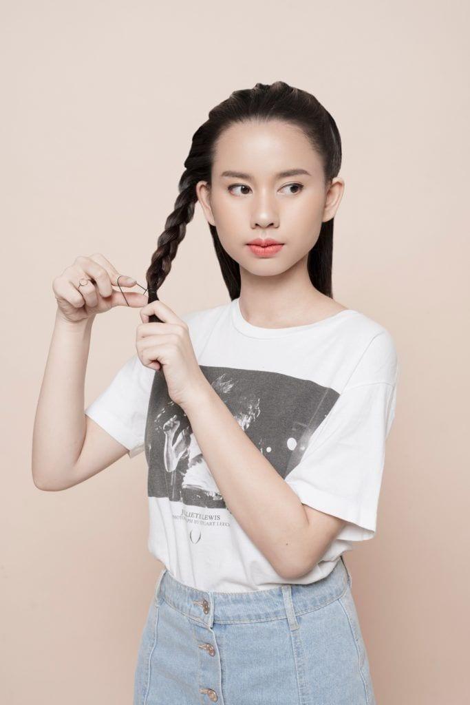 Headband braid: Asian girl creating a three-strand braid