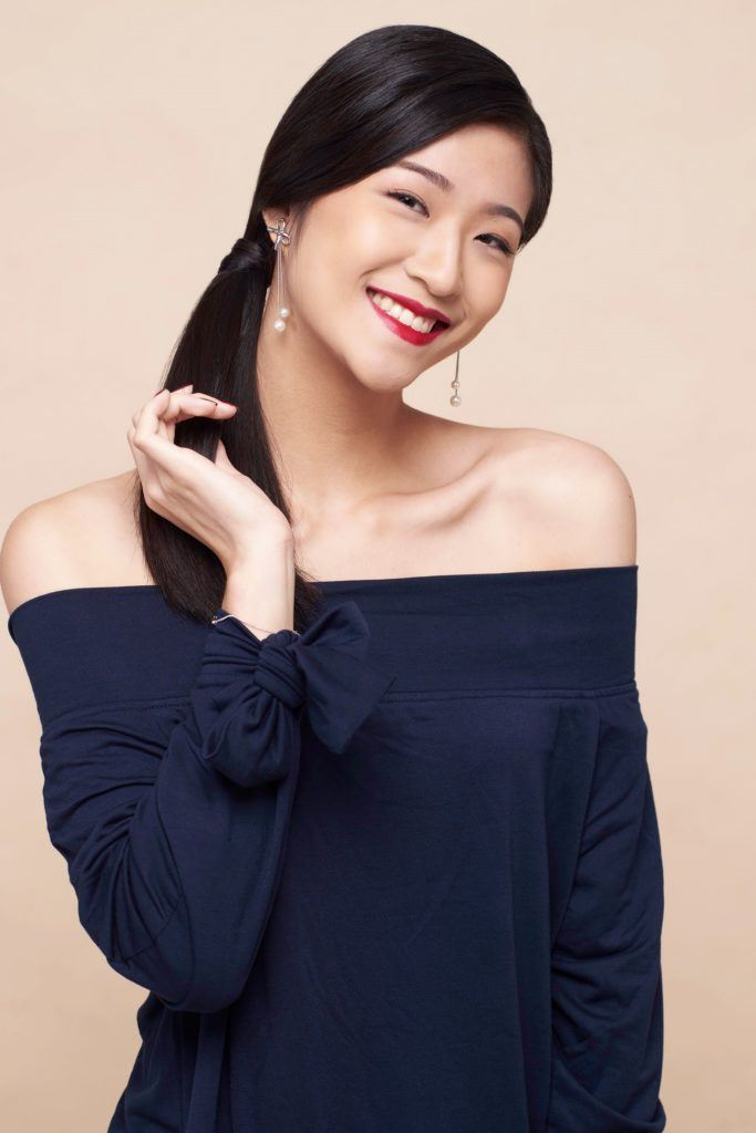 Side hairstyles: Asian woman with side ponytail