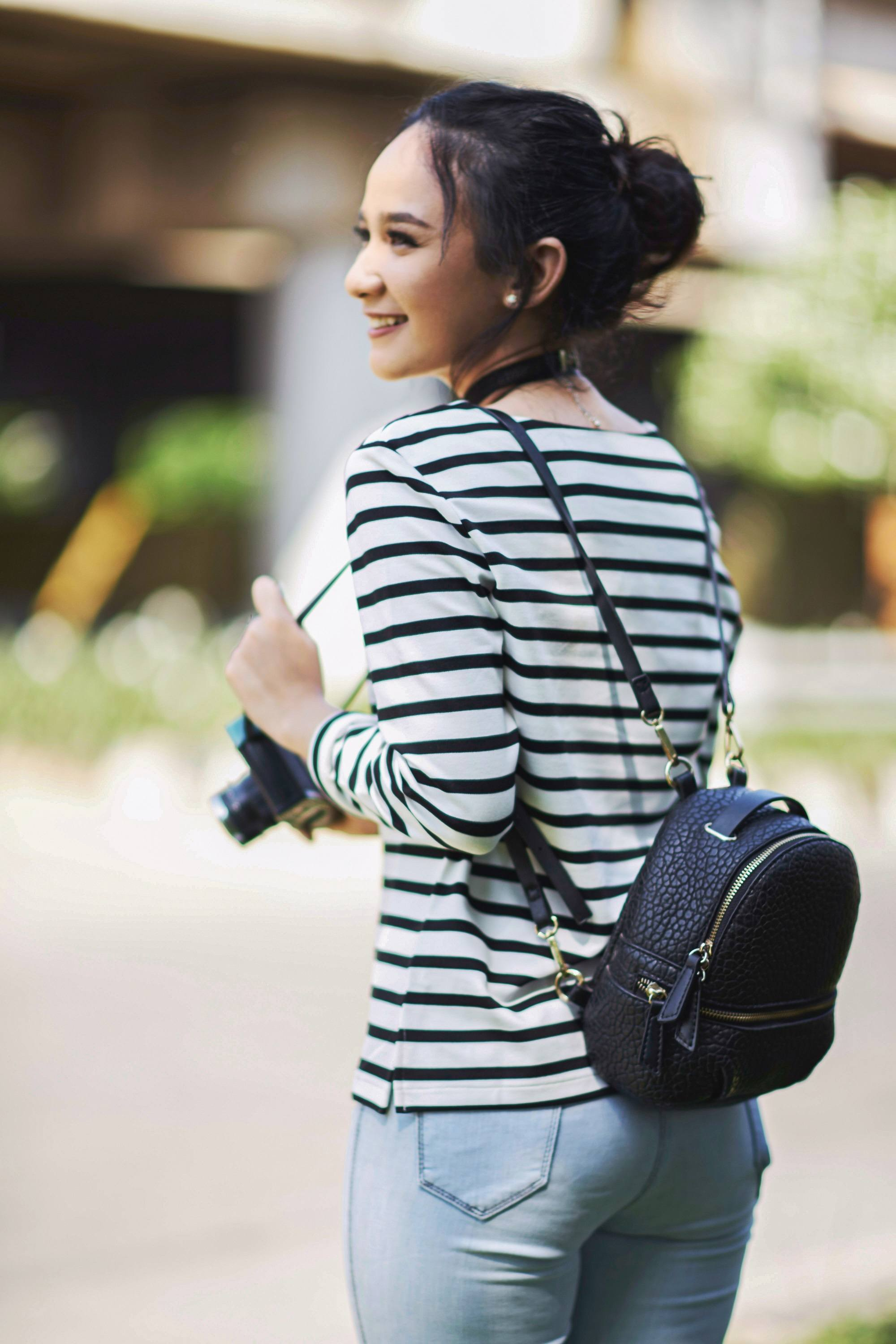 Updos for long hair: Asian girl with a messy bun hairstyle