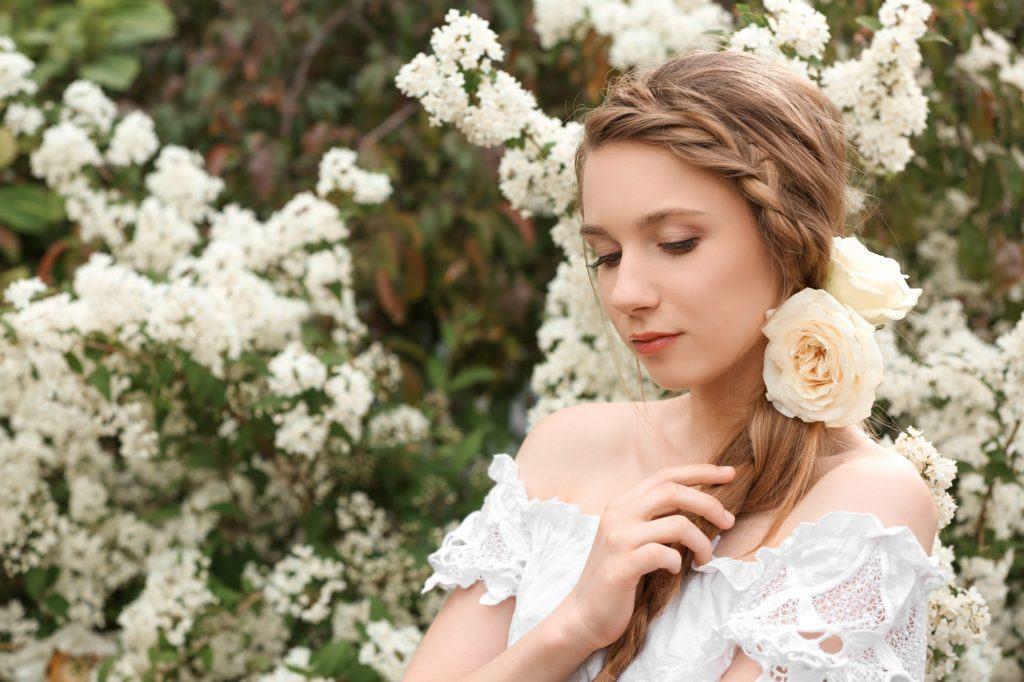 Wedding hair braids: Woman with headband side braid wearing a wedding dress