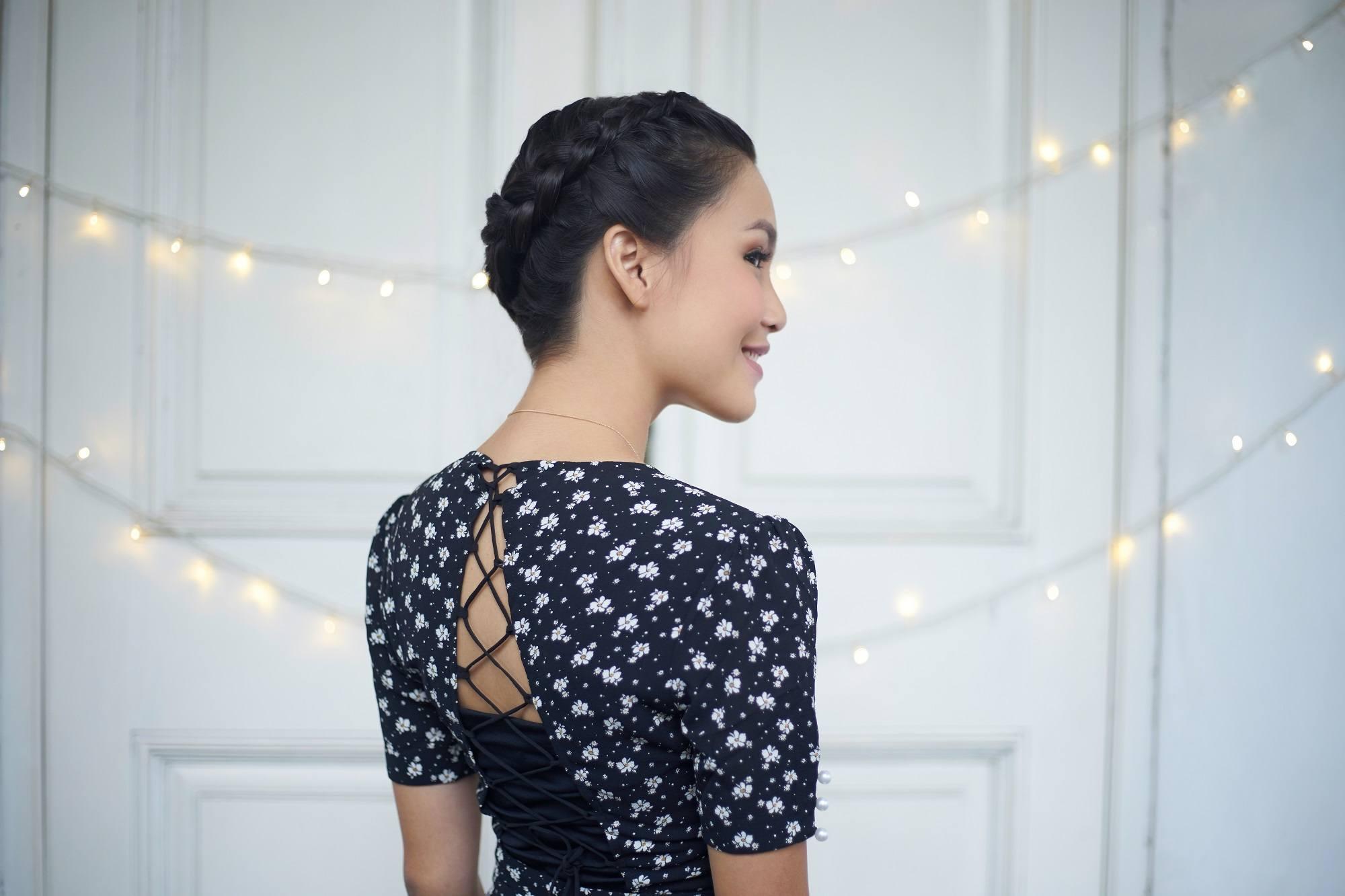 Wedding hair braid: Asian woman with black hair in halo braid