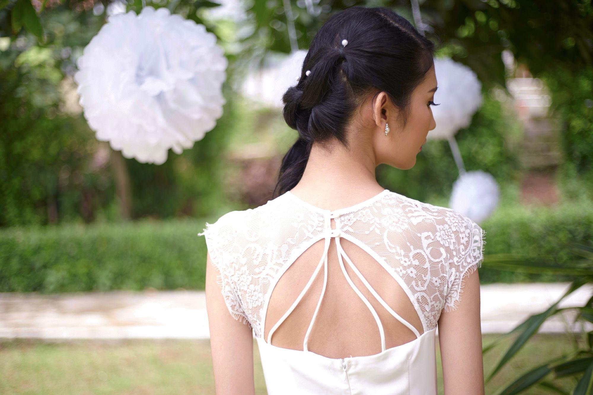 Wedding hair braids: Asian woman in white dress and pony braid hair