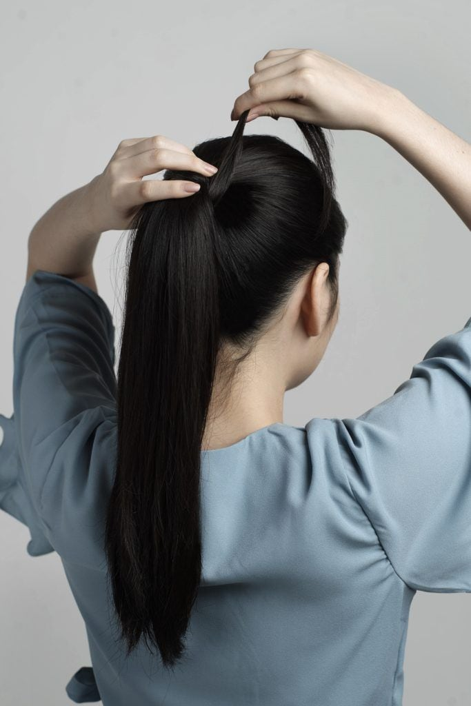 Braid ponytail: Asian woman with high ponytail