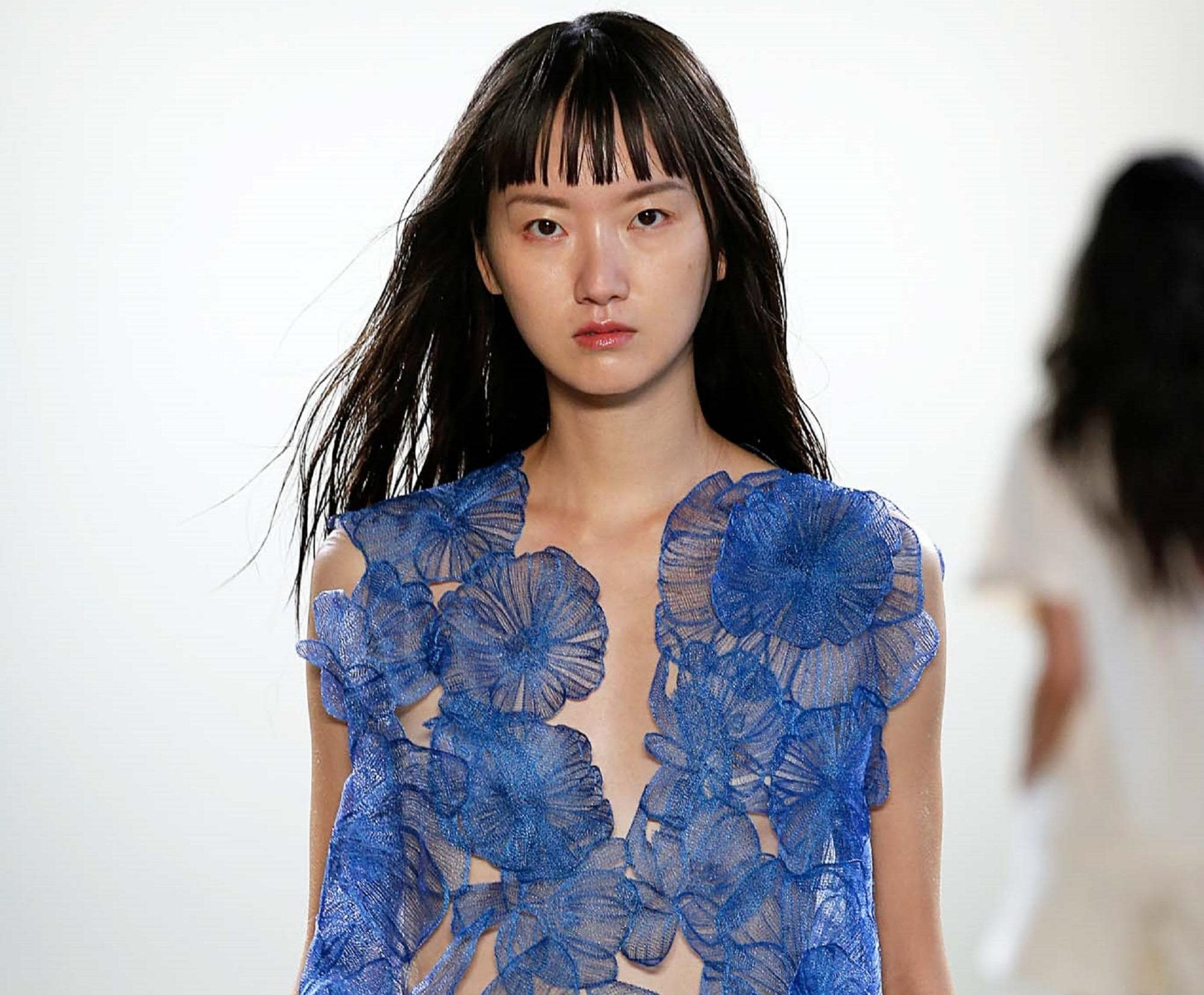 Long black hair: Closeup shot of Asian model with long black hair with bangs wearing a blue dress