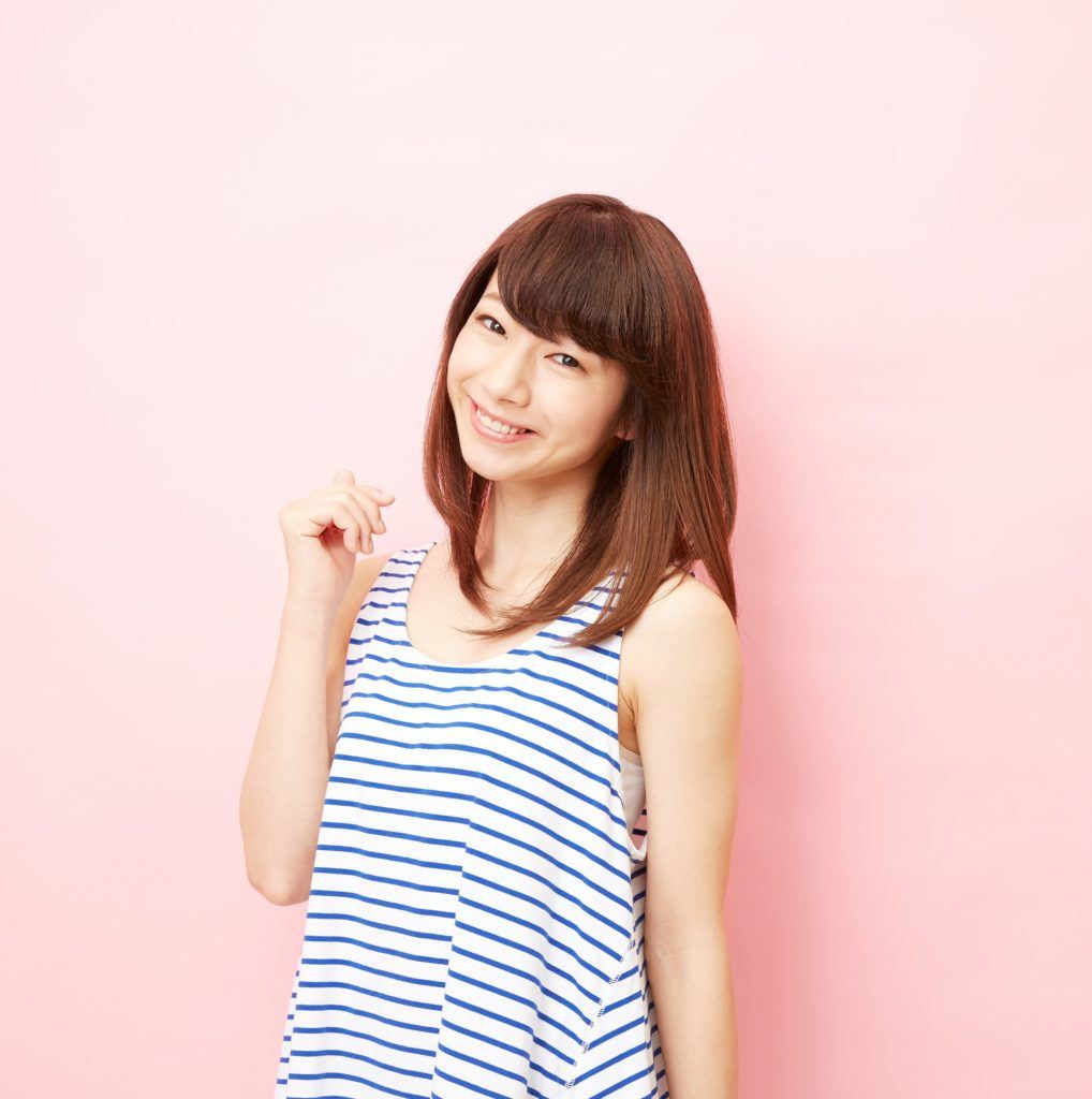 Asian woman with brown hair against pink background to represent users of new Sunsilk Smooth and Manageable Shampoo