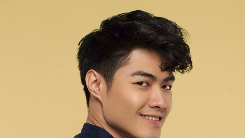 Asian man with textured and tousled medium hairstyle