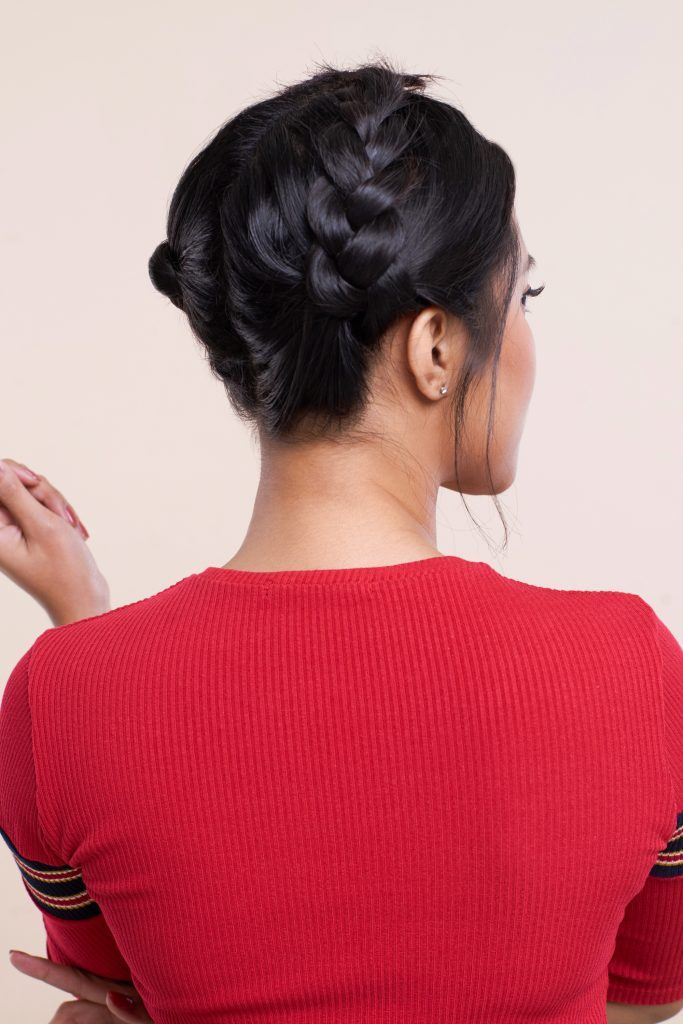 Asian woman with a crown braid hairstyle wearing a red shirt