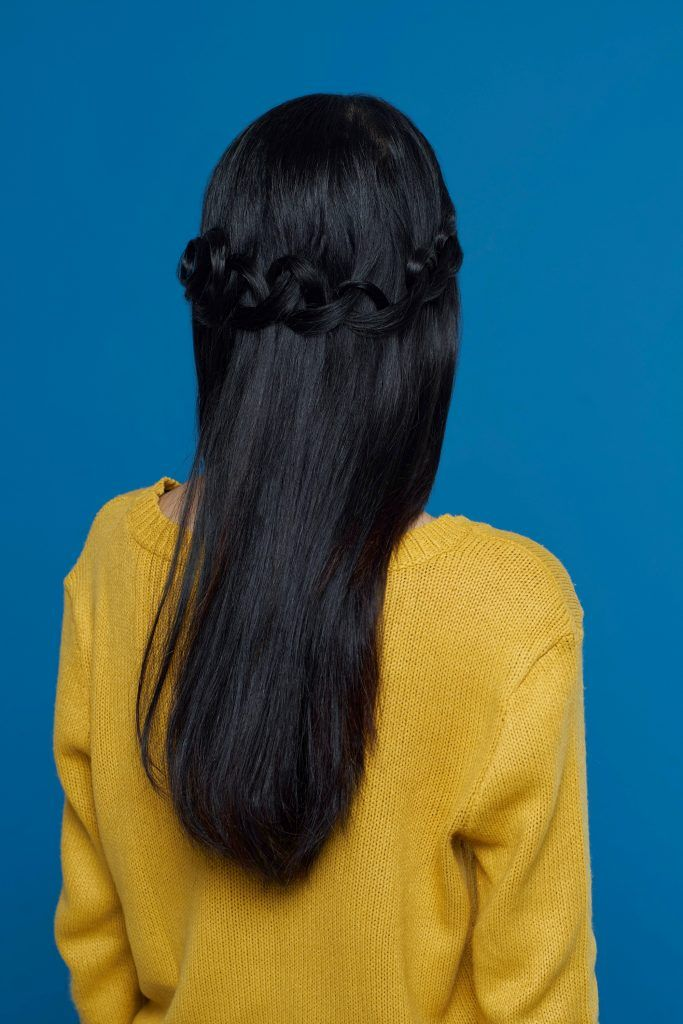 Back shot of an Asian woman with loop braid hairstyle
