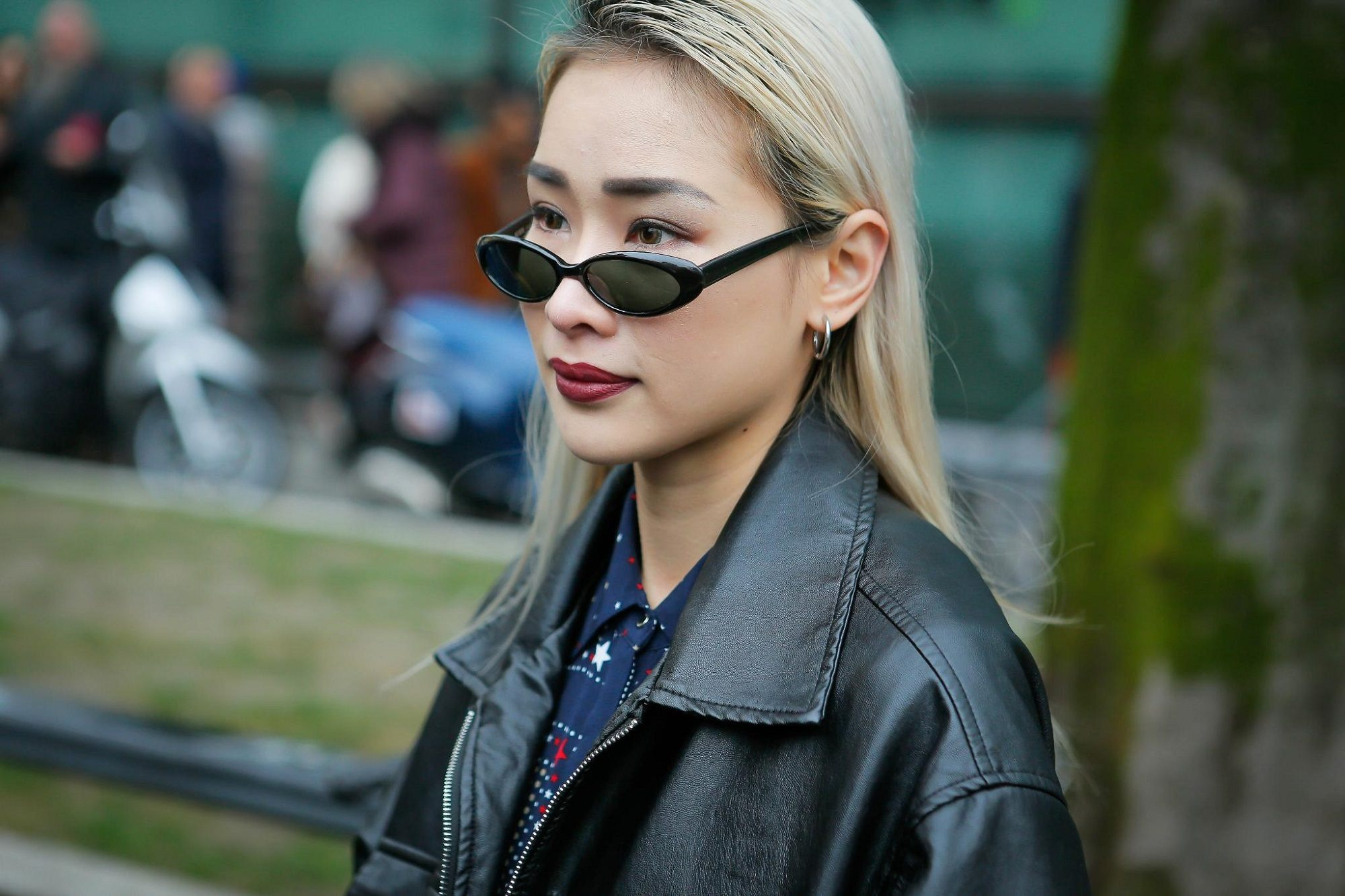 Light blonde hair: Woman with blonde hair and wearing a leather jacket in an outdoor location