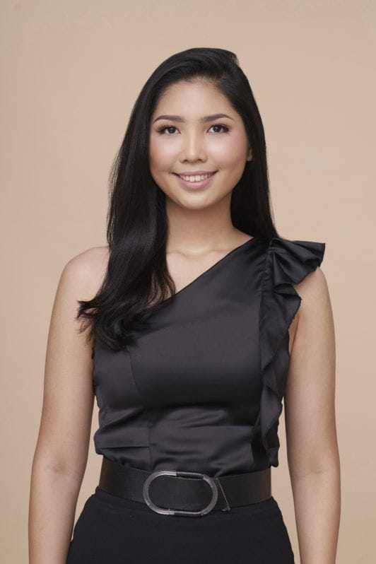 Cream Silk Triple Keratin Rescue Ultimate Straight Glamorously Straight hair: Asian woman with long black hair wearing a black top and skirt against an oyster-colored background