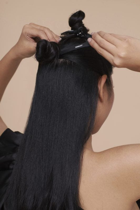Cream Silk Triple Keratin Rescue Ultimate Straight Glamorously Straight Hair: Closeup shot of an Asian woman's long black hair being clipped