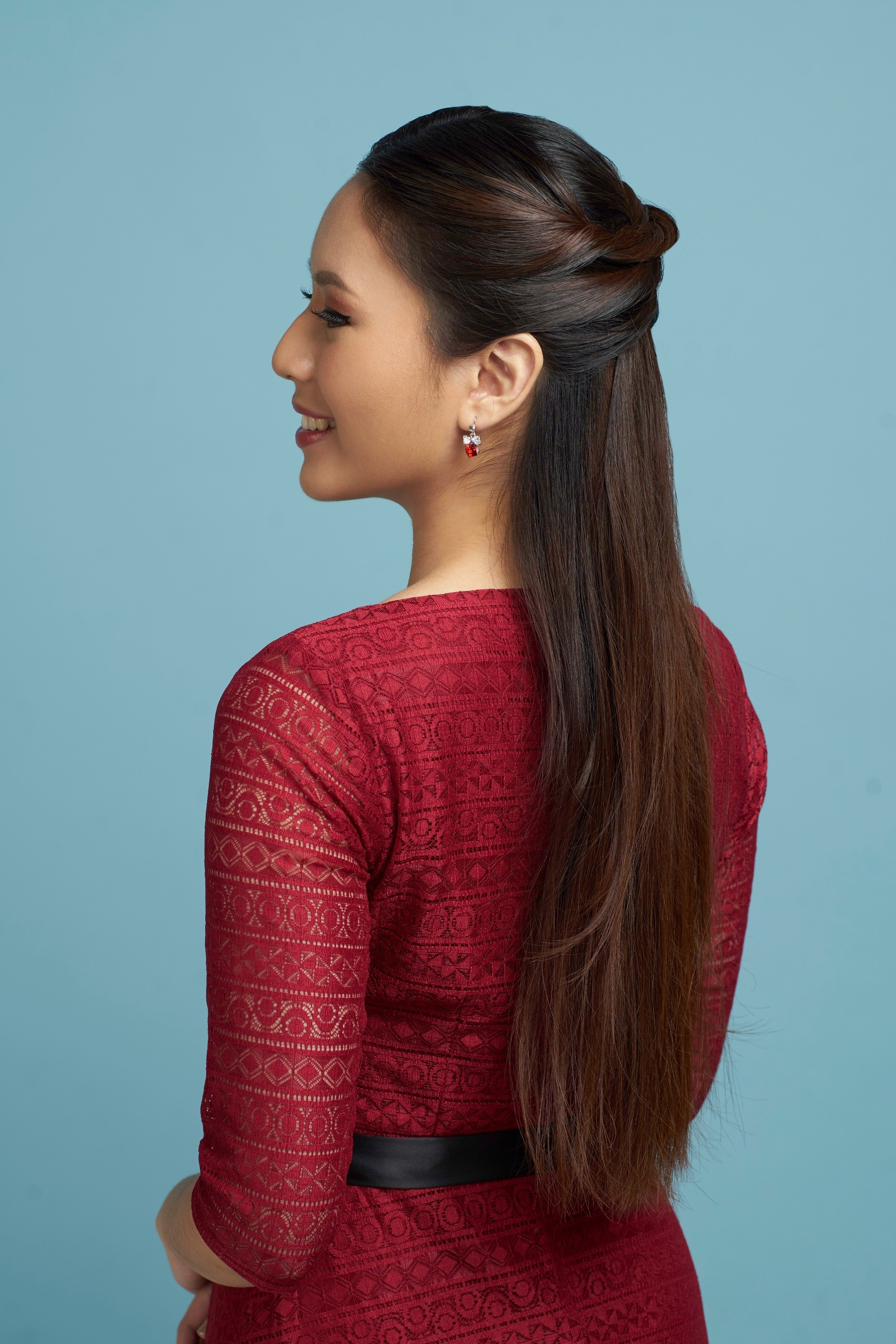 Half ponytail: Back shot of an Asian woman with long dark hair in half up criss cross hairstyle