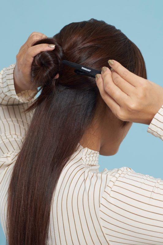 Long hair with curly side fringe: Closeup shot of an Asian woman's long dark hair being clipped