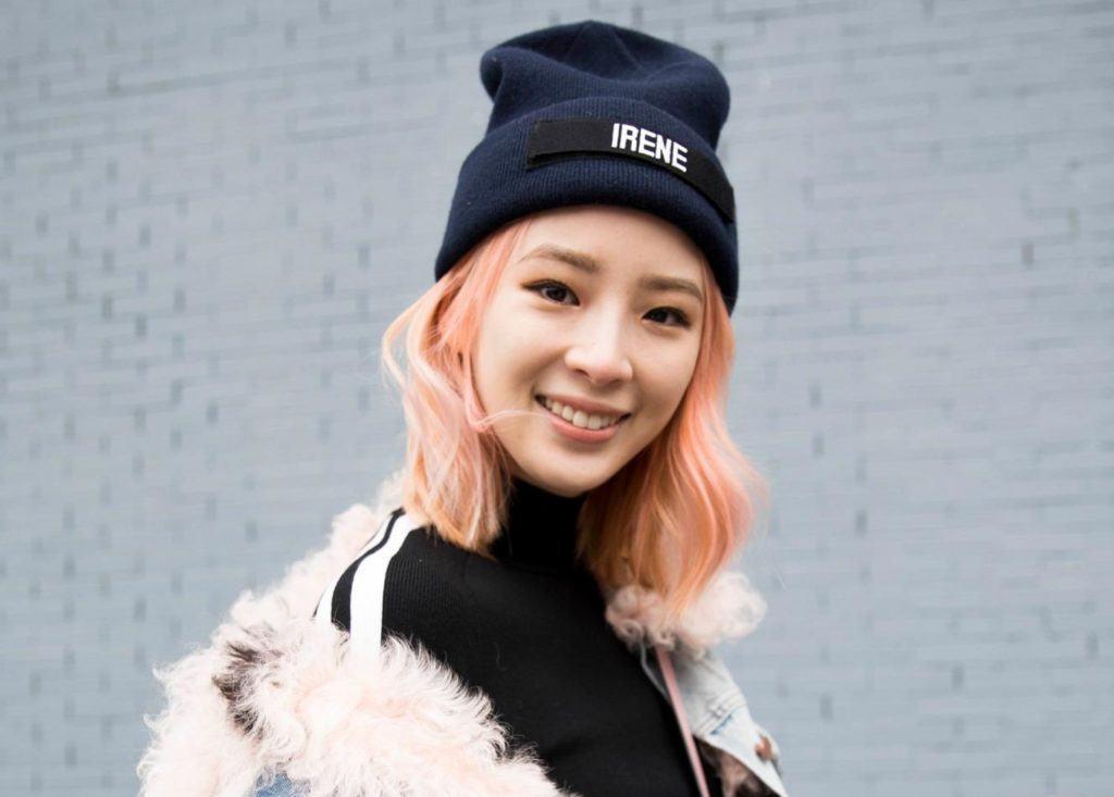 Peach hair: Asian woman with peach shoulder length hair wearing a black bonnet and black shirt