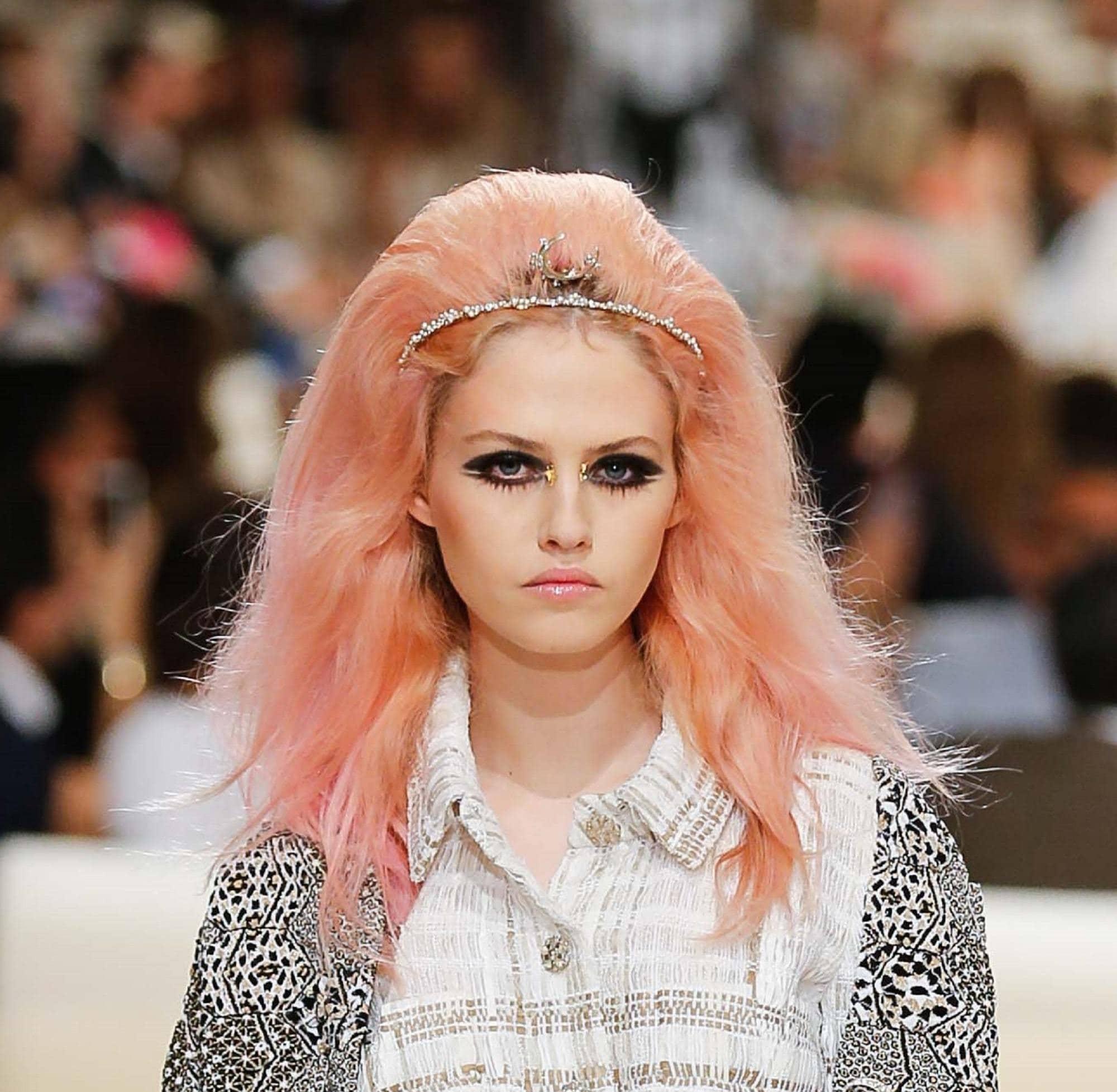 Peach hair: Closeup shot of a woman with voluminous peach hair walking the runway