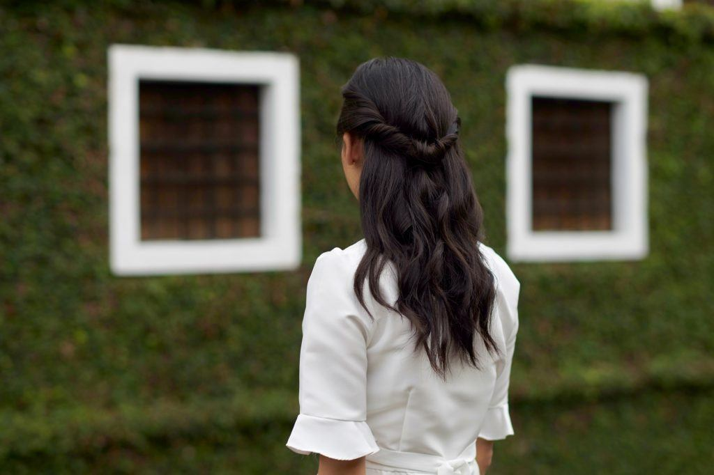 Back shot of an Asian woman with twisted ponytail half updo