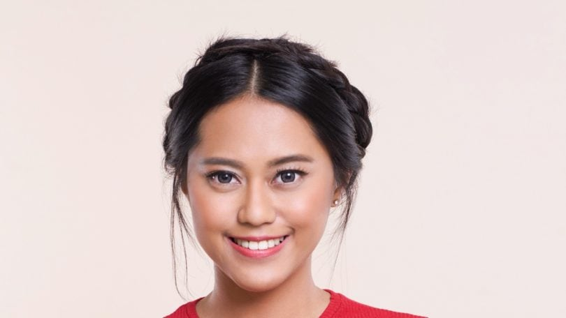 Crown braid: Closeup shot of an Asian woman wearing a red top with black hair in a crown braid