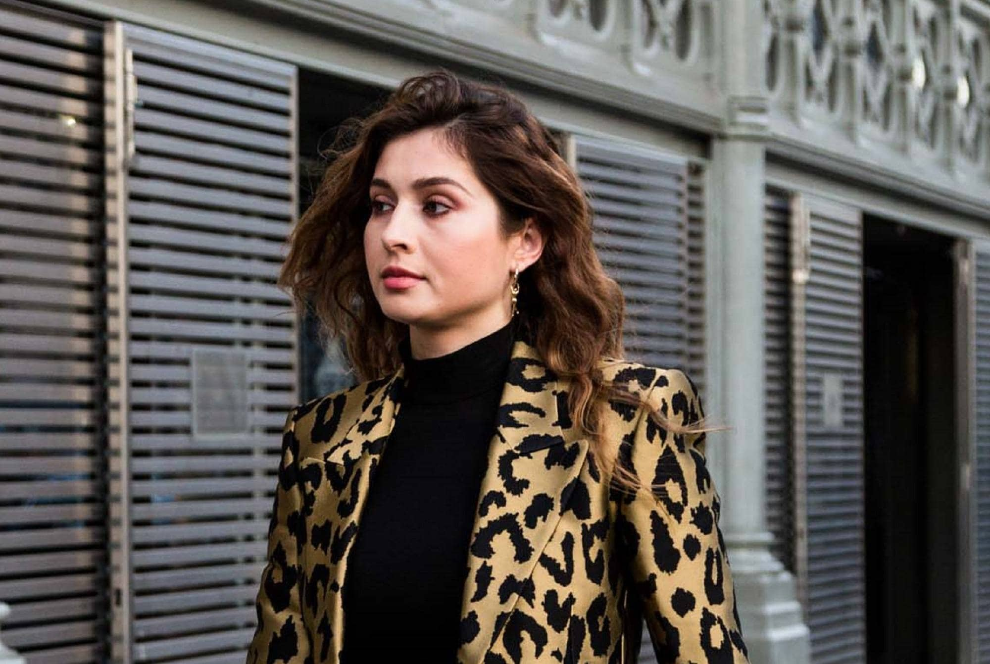 Paris Fashion Week 2019: Woman wearing a leopard print jacket with dark brown wavy lob outdoors