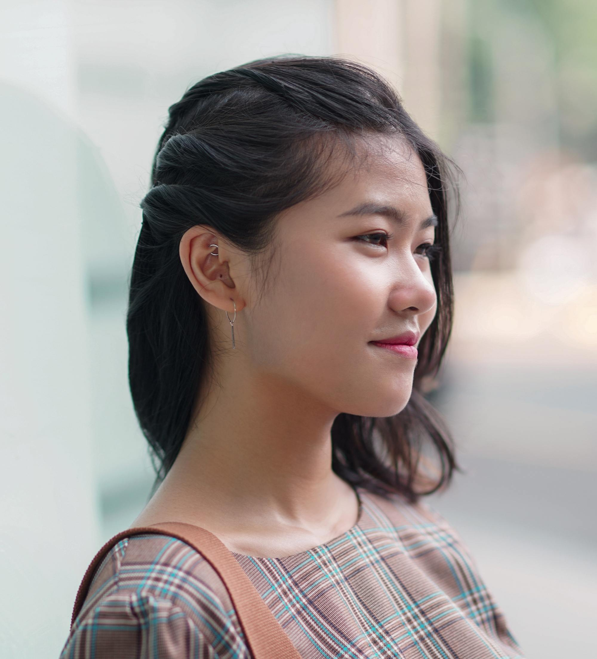 Shoulder length hairstyles: Side closeup shot of an Asian woman with styled short hair