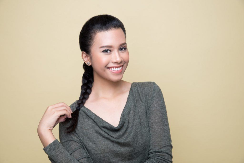 Simple braids: Asian woman wearing a dark gray long-sleeved shirt with long black hair in a French braid