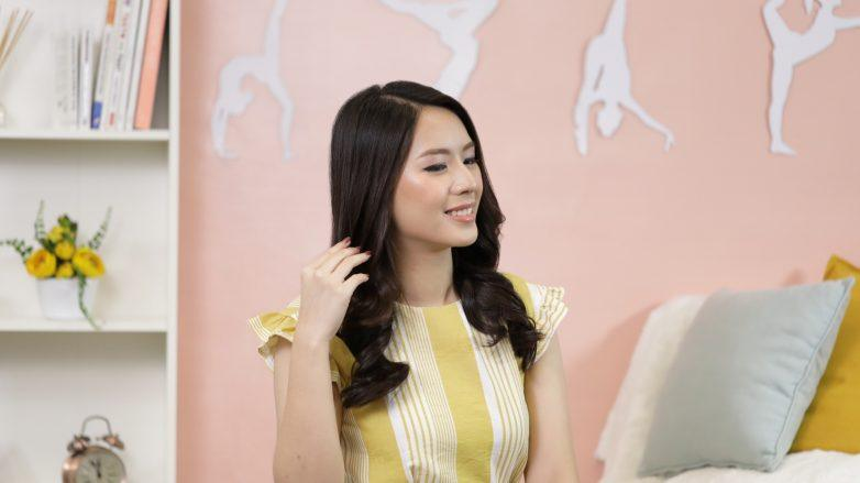Must-have hair products for the Lunar New Year: Asian woman with long hair sitting and smiling