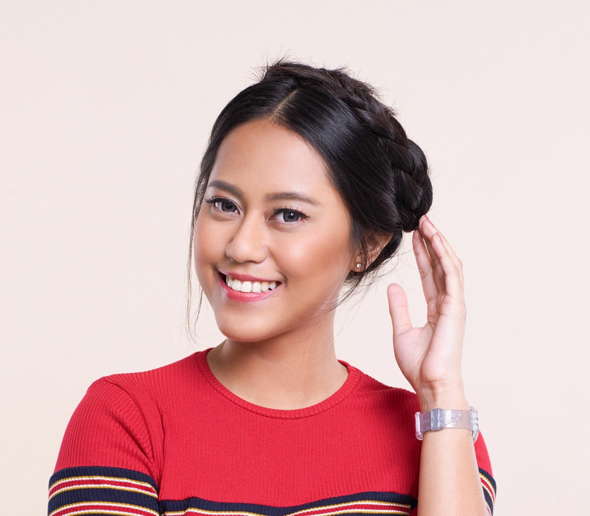 Closeup shot of an Asian woman with short black hair in crown braid