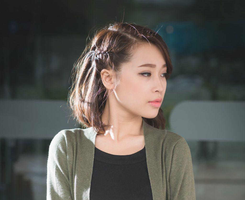 Easy braids for short hair: Closeup shot of a Vietnamese woman with short dark hair