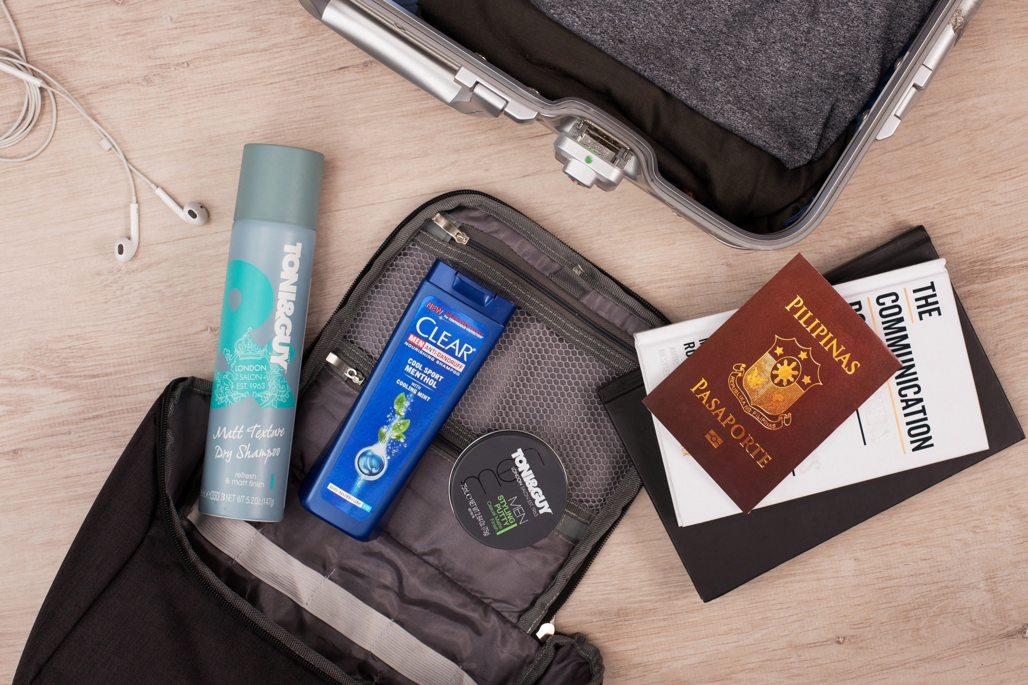 Flatlay of travel essentials and hair products