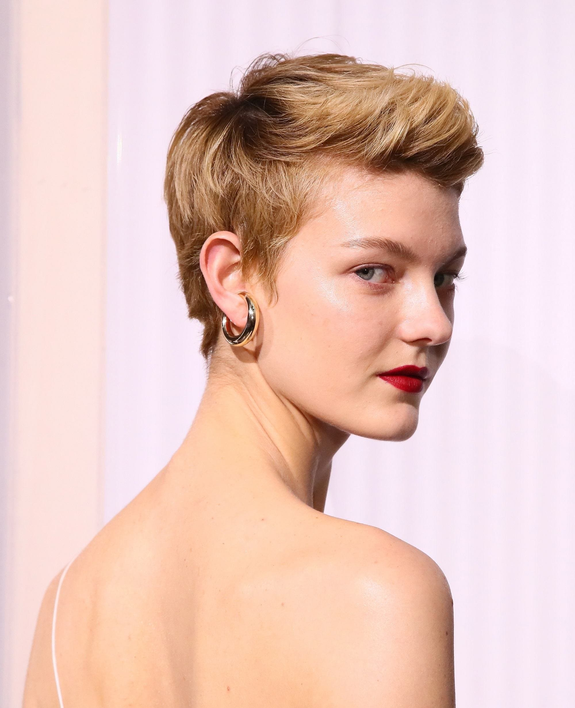 NYFW hair must-haves: Closeup shot of a woman with short blonde pixie cut hair