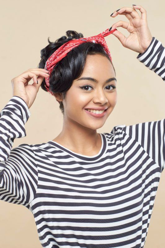 Pin up hair: Asian woman with long black hair in an updo putting a red scarf on her head