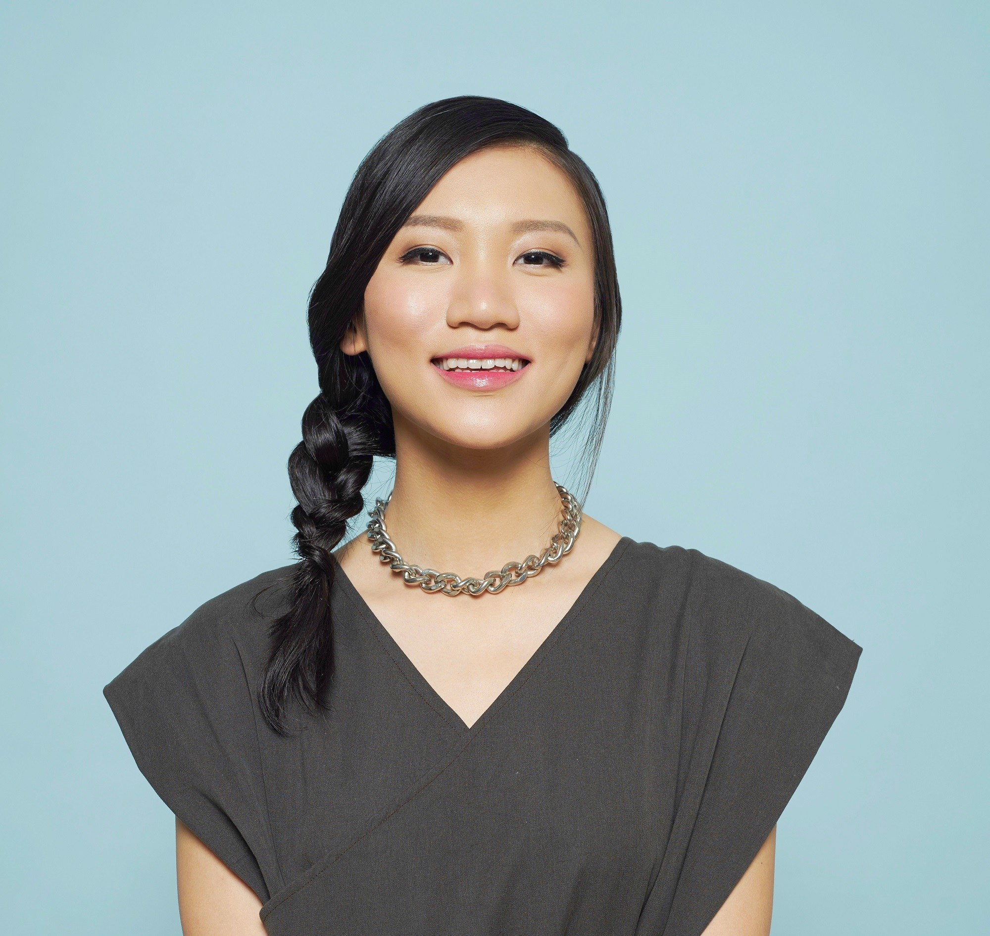 Pretty braids: Closeup shot of an Asian woman with long black hair in a side braid