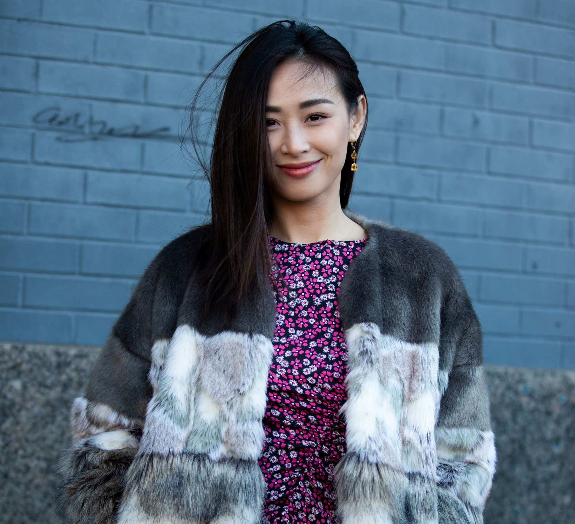 Street style hair inspiration: Asian woman with long straight black hair wearing a coat outdoors