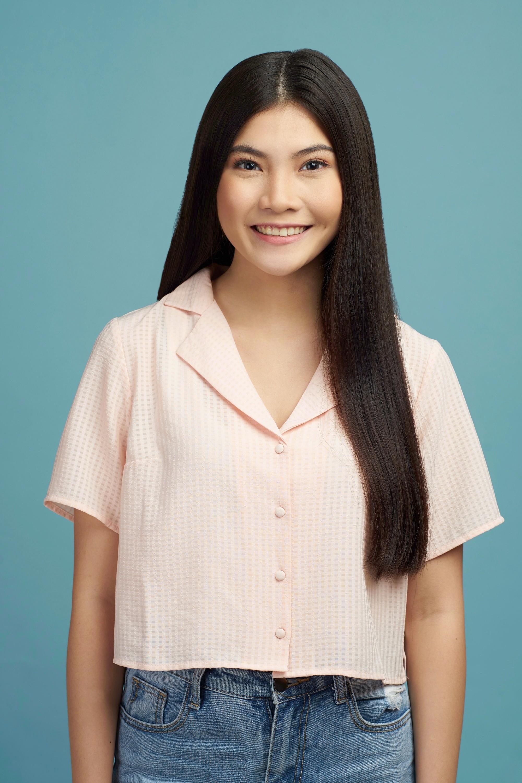 Hair care hacks: Asian woman with long black straight hair wearing a peach blouse