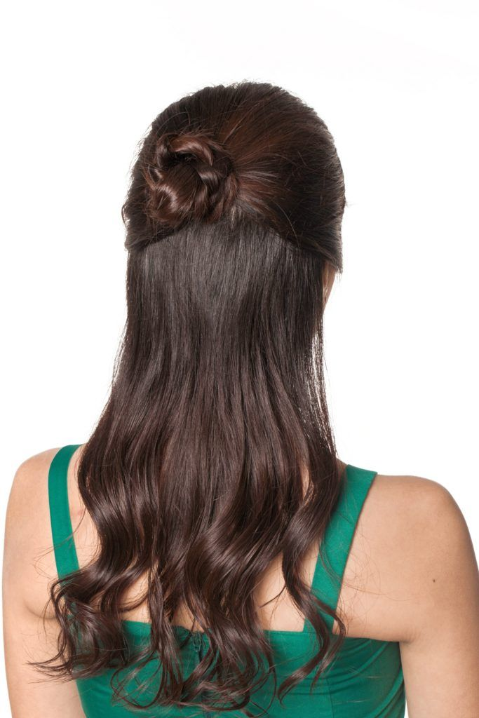 Half updo with bun: Back shot of an Asian woman with long dark hair in a half updo with bun