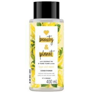 Bottle of Love Beauty and Planet yellow conditioner