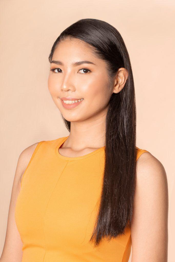 Sleek and fierce ponytail: Closeup shot of an Asian woman with long straight black hair