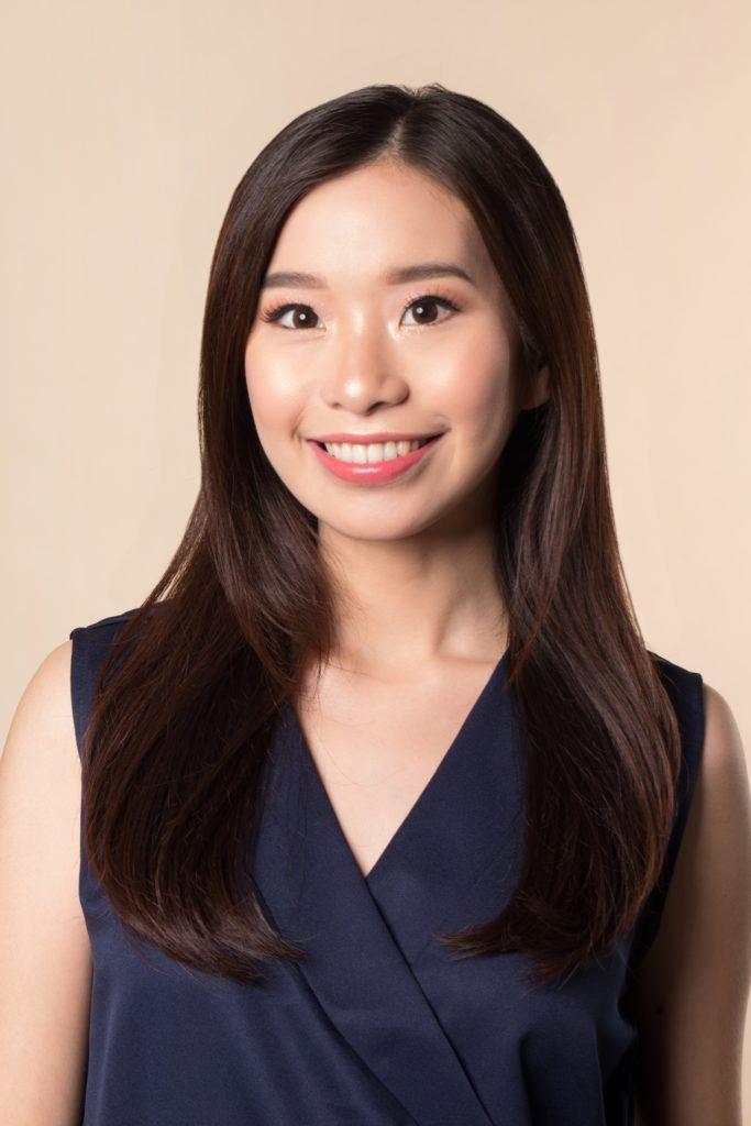 Vintage Ponytail: Asian woman with long dark hair wearing a dark blue sleeveless blouse