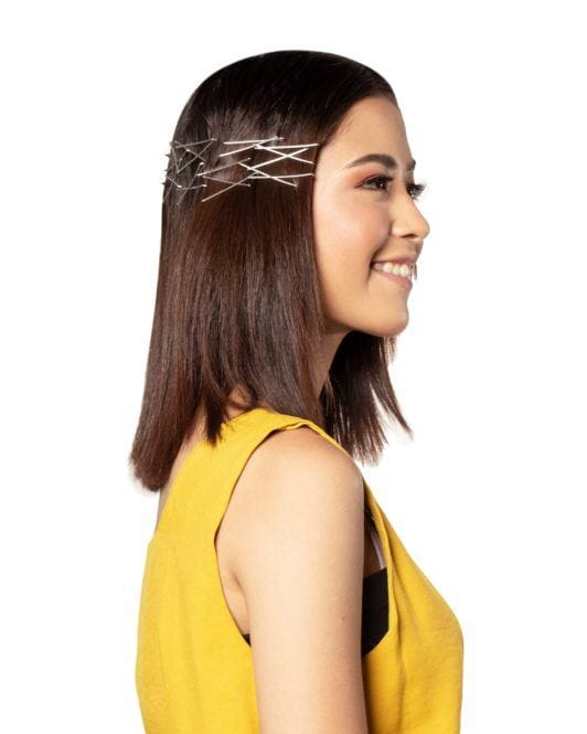 Bobby pin hair crown: Side view of an Asian woman with bobby pin hair crown on her dark shoulder-length hair and smiling