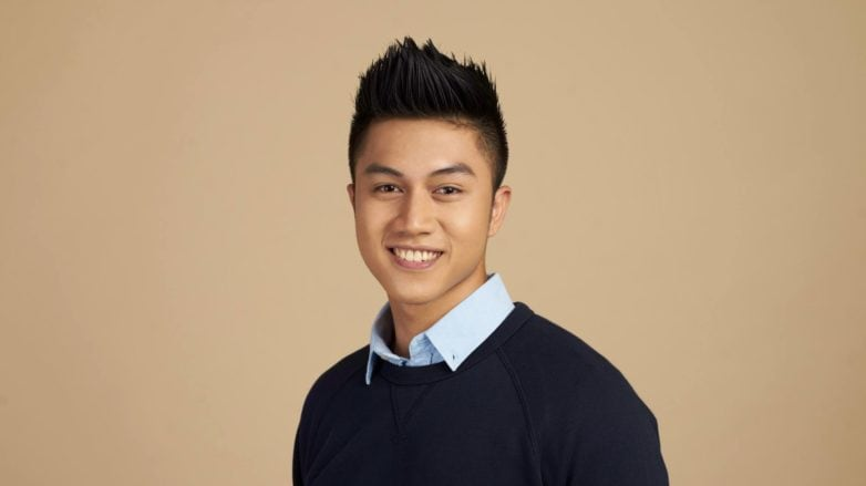 Hair care tips for men: Asian man with black hair smiling