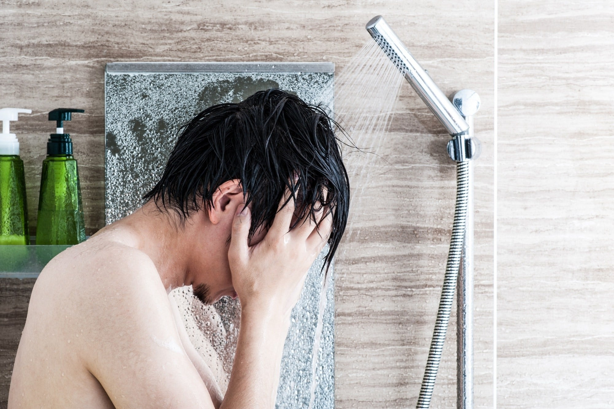 Hair care tips for men: Man covering her face in the shower